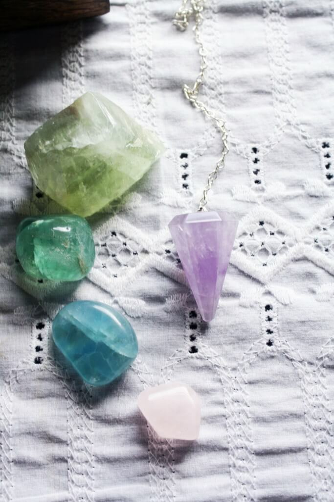 Flourite crystals and amethyst pendulum
